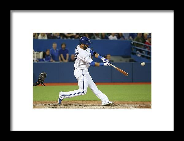 American League Baseball Framed Print featuring the photograph Baltimore Orioles V Toronto Blue Jays by Tom Szczerbowski