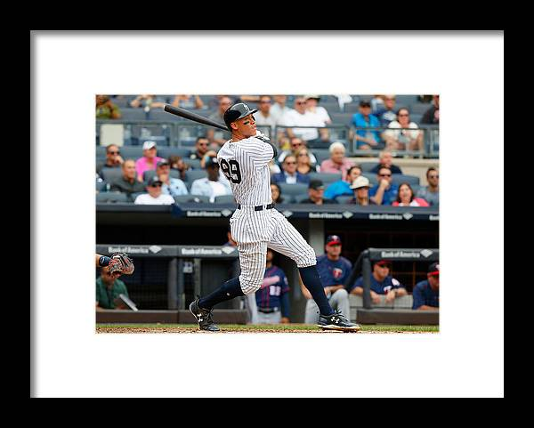 Following Framed Print featuring the photograph Minnesota Twins v New York Yankees by Jim McIsaac