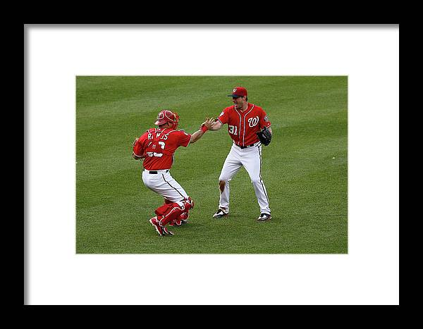 Baseball Catcher Framed Print featuring the photograph Pittsburgh Pirates V Washington by Rob Carr