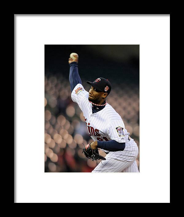 Game Two Framed Print featuring the photograph Toronto Blue Jays V Minnesota Twins - by Hannah Foslien