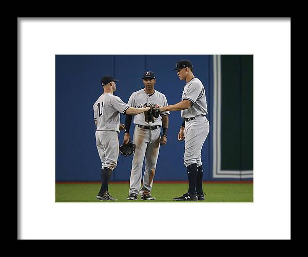 People Framed Print featuring the photograph New York Yankees v Toronto Blue Jays by Tom Szczerbowski