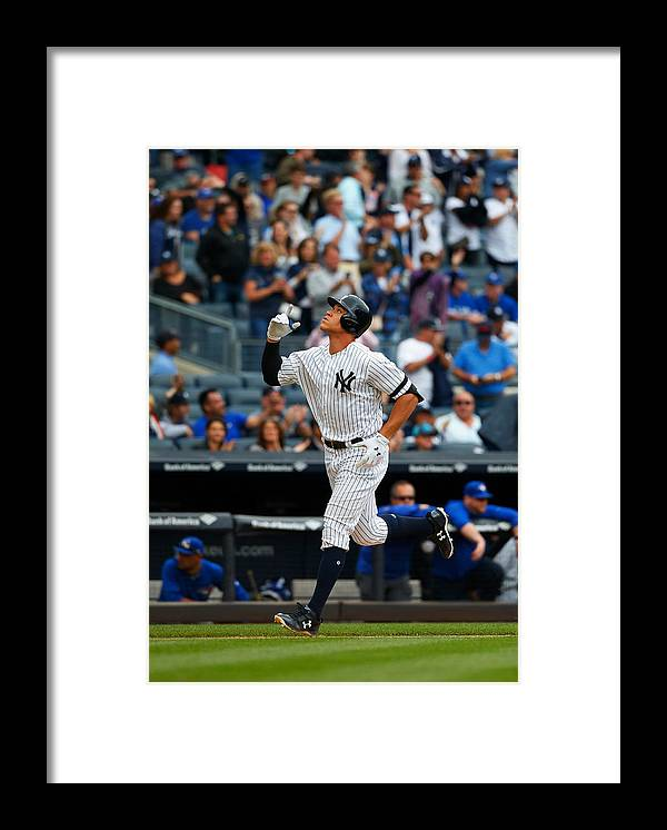 People Framed Print featuring the photograph Toronto Blue Jays v New York Yankees by Jim McIsaac