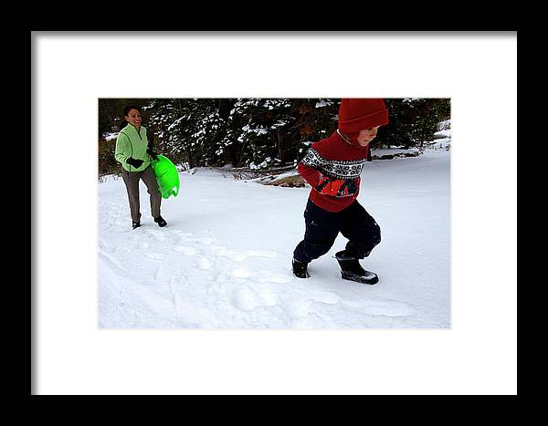 Action Framed Print featuring the photograph A Young Boy And Mother Sledding by Corey Rich
