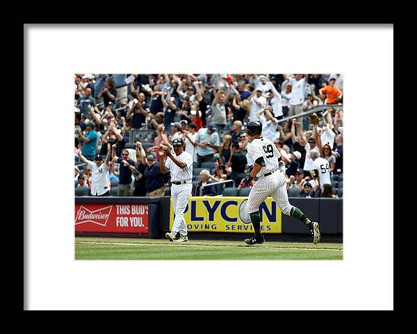 People Framed Print featuring the photograph Oakland Athletics v New York Yankees by Elsa