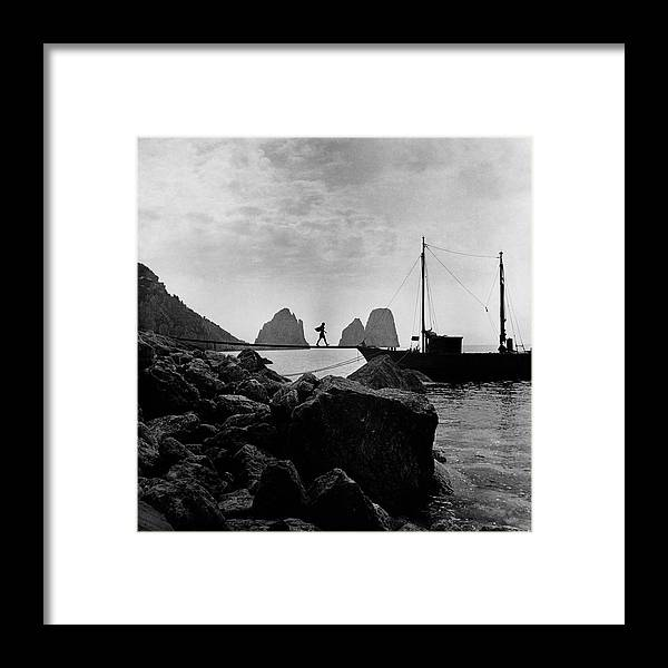 Capri Framed Print featuring the photograph A Boat Docked At Capri by Clifford Coffin