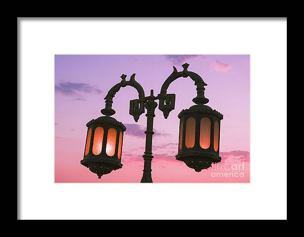 Dahab Framed Print featuring the photograph A Characteristic Lamp Post In The City Of Dahab At Dusk by Roberto Morgenthaler