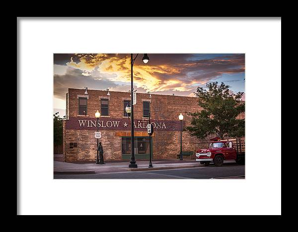 Winslow Framed Print featuring the photograph A Corner In Winslow Arizona by Richard Herman