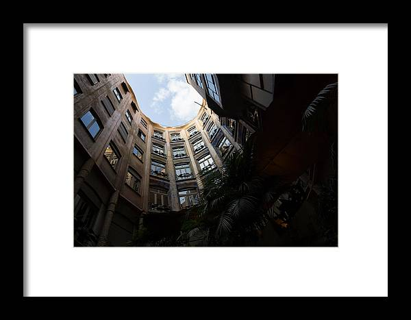 La Pedrera Framed Print featuring the photograph A Courtyard Curved Like A Hug - Antoni Gaudi's Casa Mila Barcelona Spain by Georgia Mizuleva