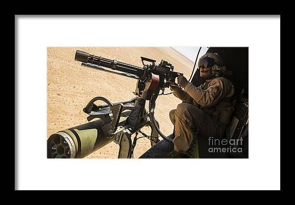 A Crew Chief Mounts A M134 Minigun Framed Print