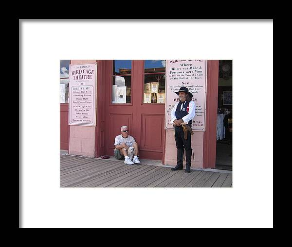 Dog Re-enactor Bird Cage Theater Tombstone Arizona Rendezvous Of The Gunfighters Framed Print featuring the photograph A Dog And A Re-enactor Rest In The Front Of The Bird Cage Theater Tombstone Arizona by David Lee Guss