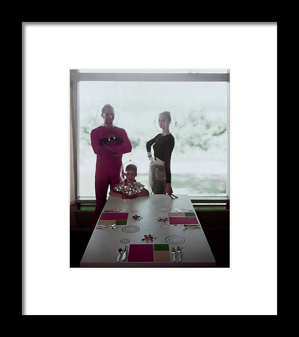 Indoors Framed Print featuring the photograph A Family Posing By A Dining Table by Otto Maya