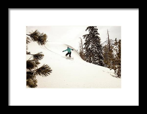 California Framed Print featuring the photograph A Female Snowboarder Lays Out Some by Kyle Sparks