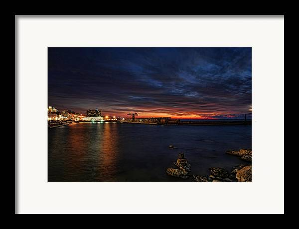 Israel Framed Print featuring the photograph a flaming sunset at Tel Aviv port by Ron Shoshani