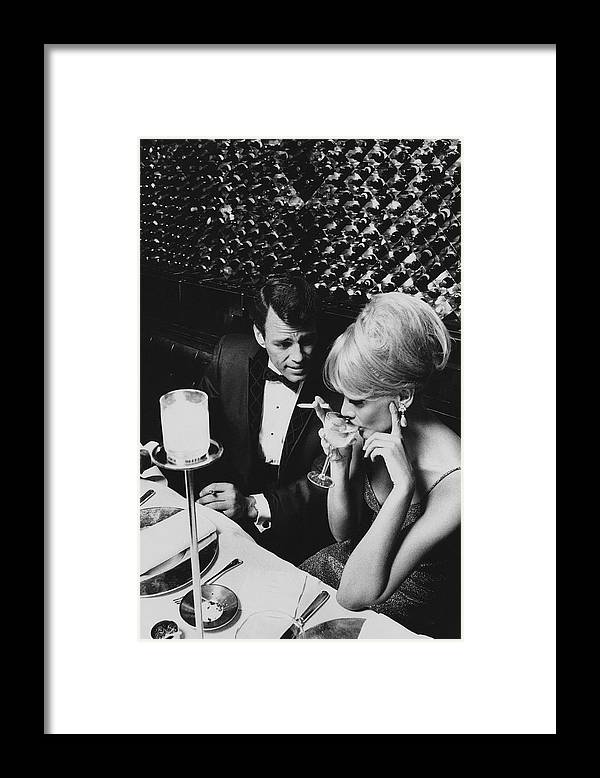 Architecture Framed Print featuring the photograph A Glamorous 1960s Couple Dining by Horn & Griner