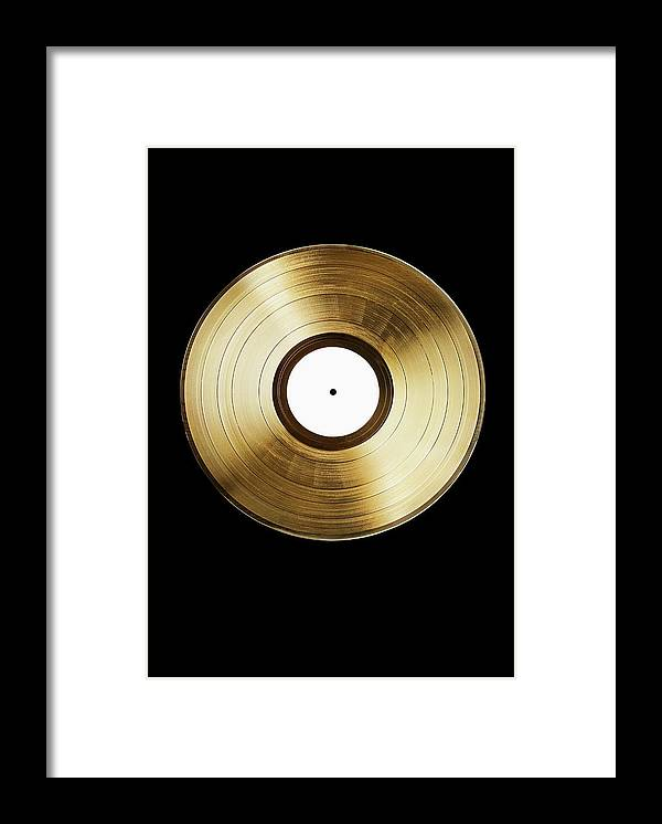 Simplicity Framed Print featuring the photograph A Gold Record On A Black Background by Larry Washburn