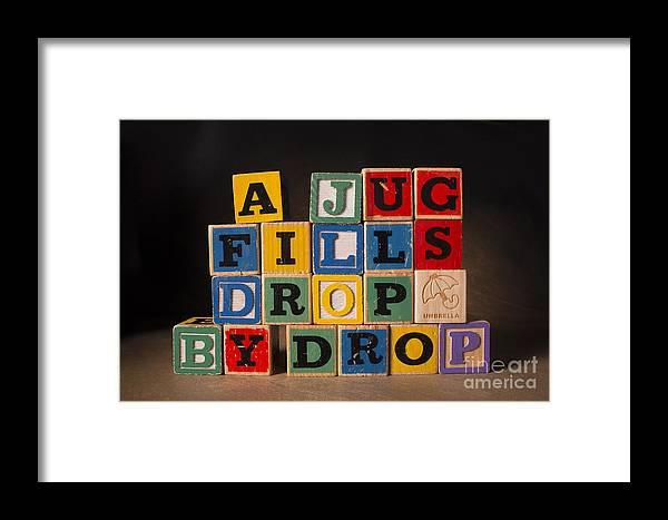 A Jug Fills Drop By Drop Framed Print featuring the photograph A Jug Fills Drop By Drop by Art Whitton
