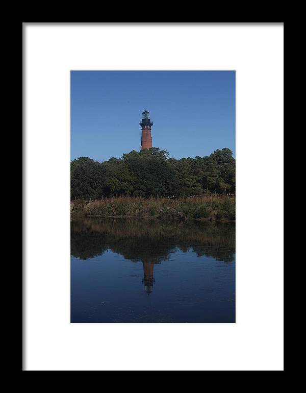 Lighthouse Framed Print featuring the photograph A Lighthouse Reflection by Darlene Neisess