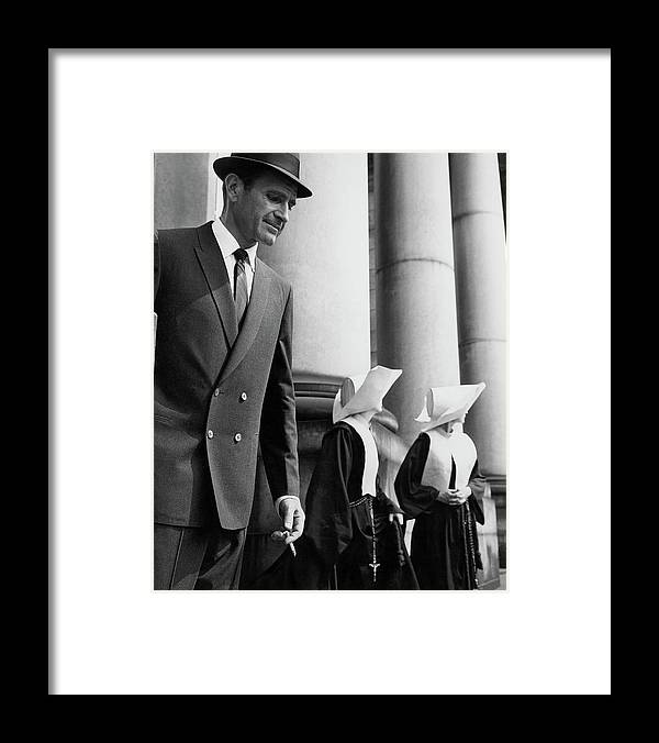 Fashion Framed Print featuring the photograph A Man Wearing A Suit And Two Nuns by Emme Gene Hall