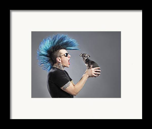 Wild Framed Print featuring the photograph A Man With A Blue Mohawk Yells At His by Leah Hammond