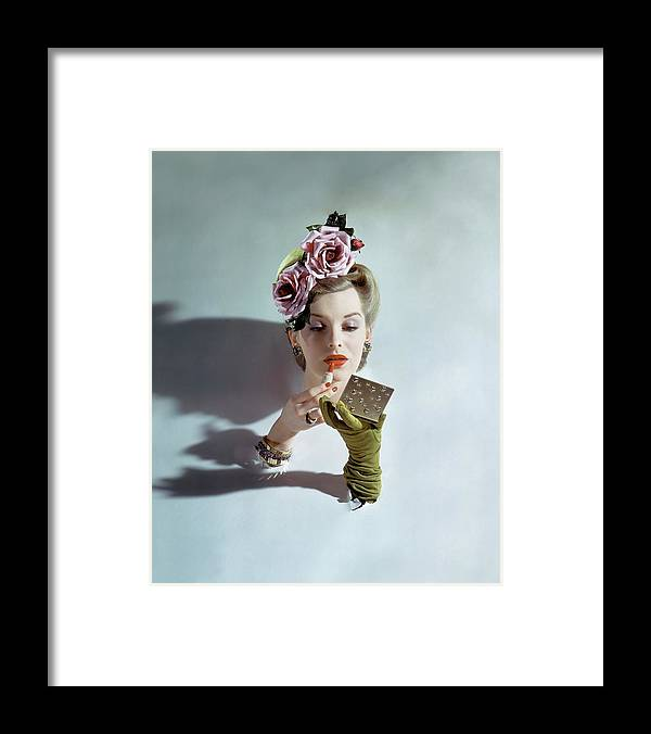 Accessories Framed Print featuring the photograph A Model Applying Lipstick by John Rawlings