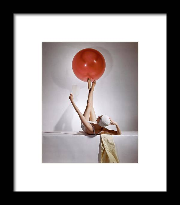 Fashion Framed Print featuring the photograph A Model Balancing A Red Ball On Her Feet by Horst P Horst