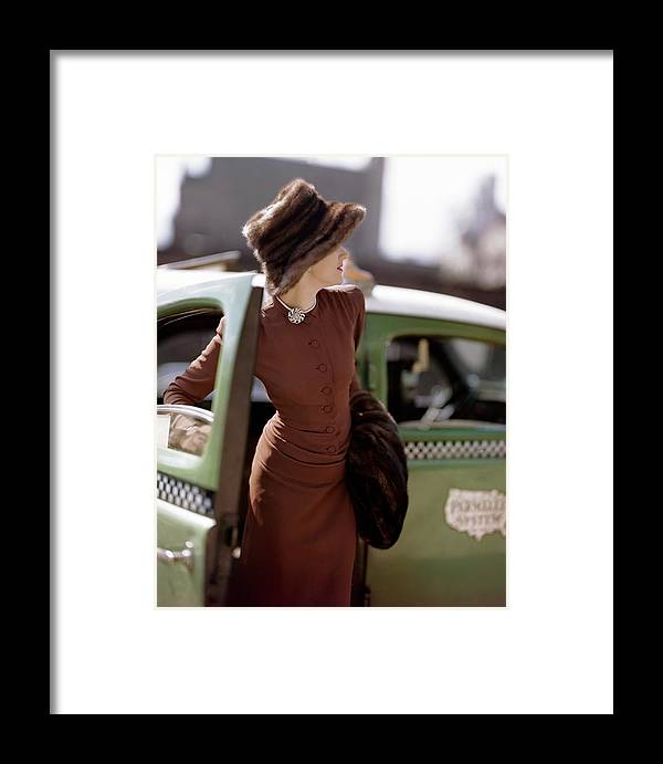 Fashion Framed Print featuring the photograph A Model Getting Out Of A Cab by Constantin Joffe