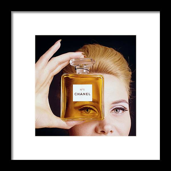 Beauty Framed Print featuring the digital art A Model Holding A Bottle Of Perfume by Fotiades