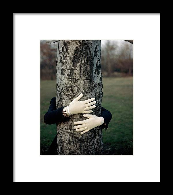 Fashion Framed Print featuring the photograph A Model Hugging A Tree by Frances Mclaughlin-Gill