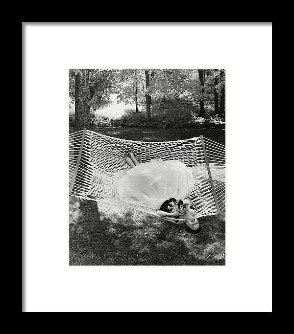 Landscape Framed Print featuring the photograph A Model Lying On A Hammock by Gene Moore