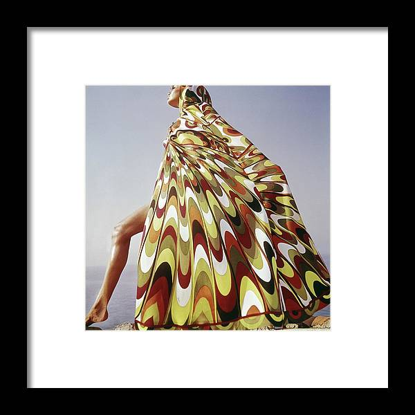 Exterior Framed Print featuring the photograph A Model Posing In A Colorful Cover-up by Henry Clarke