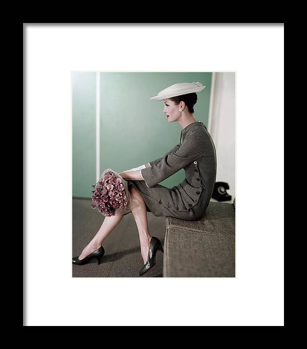 A Model Sitting Down With A Bouquet Of Flowers Framed Print By Karen