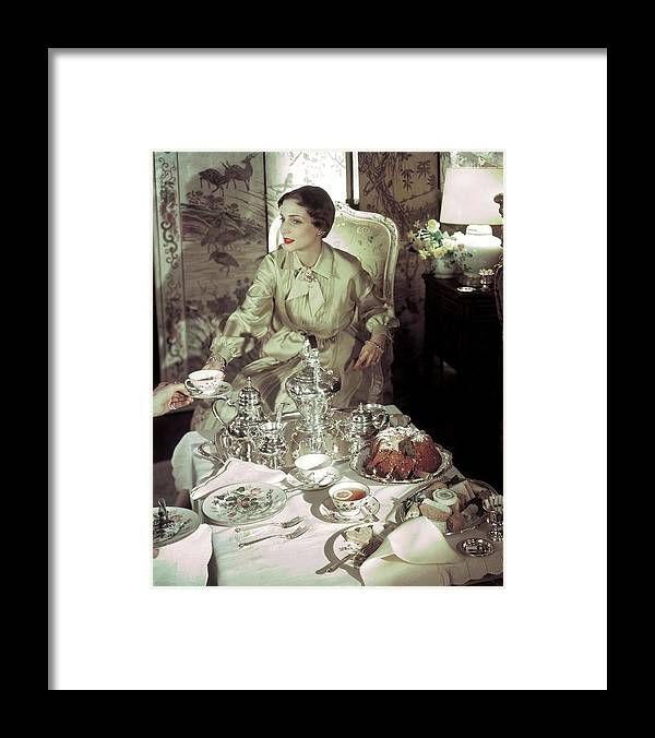 Model Framed Print featuring the photograph A Model Sitting In A Lavish Dining Room by Horst P. Horst