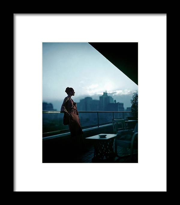 Fashion Framed Print featuring the photograph A Model Wearing A Clare Potter Dress At Moma by Constantin Joffe