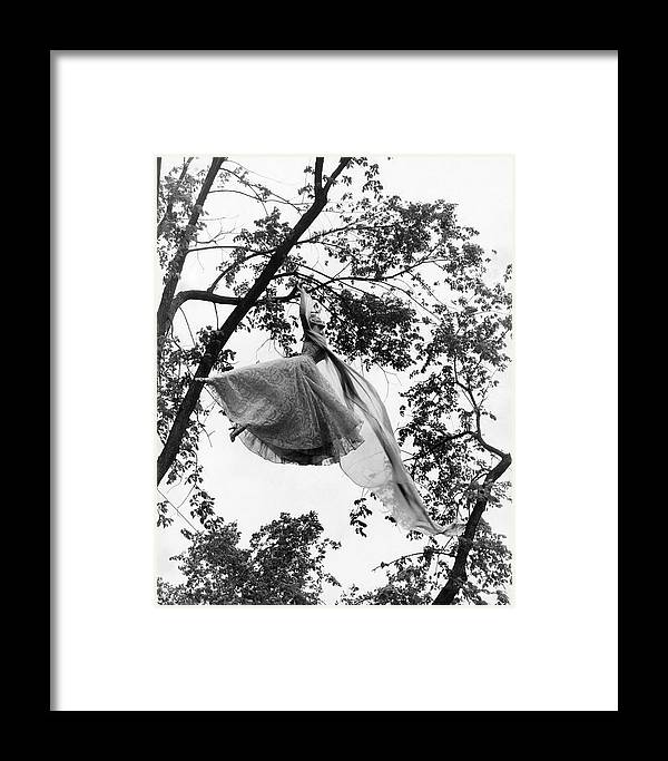 Beauty Framed Print featuring the photograph A Model Wearing A Dress In A Tree by Gene Moore