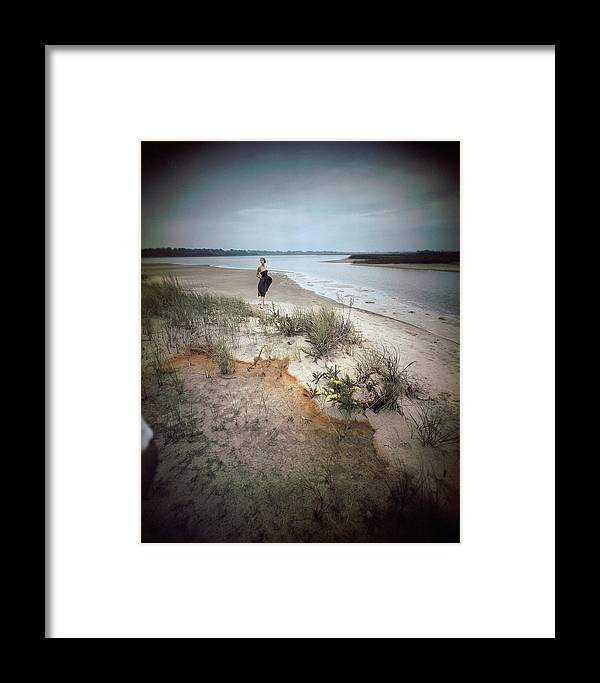 Fashion Framed Print featuring the photograph A Model Wearing A Dress On A Beach by Serge Balkin