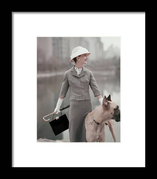 Fashion Framed Print featuring the photograph A Model Wearing A Gray Suit With A Dog by Karen Radkai