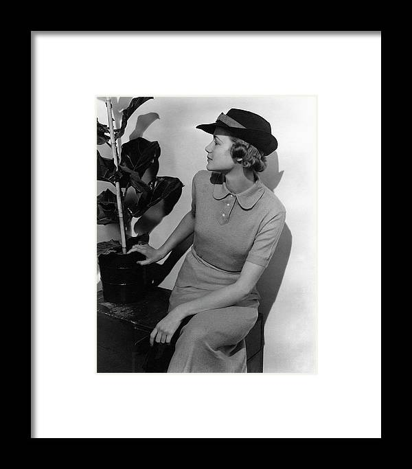 Fashion Framed Print featuring the photograph A Model Wearing A Knit Dress by Lusha Nelson