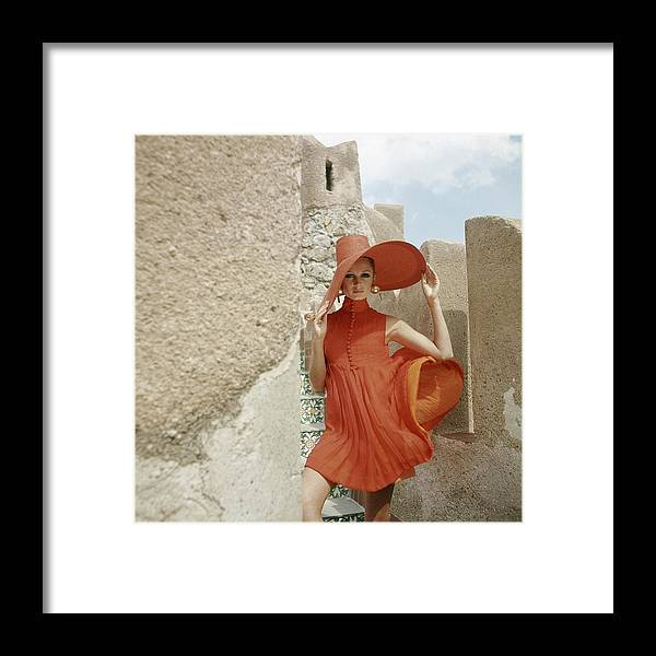Fashion Framed Print featuring the photograph A Model Wearing A Orange Dress by Henry Clarke