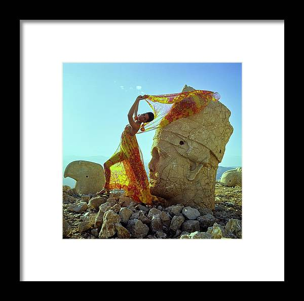 Fashion Framed Print featuring the photograph A Model Wearing A Pauline Trigere Dress And Scarf by Henry Clarke