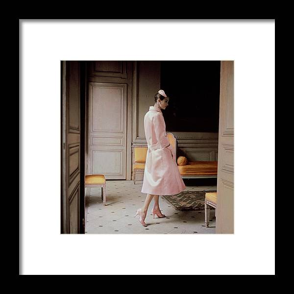 Fashion Framed Print featuring the photograph A Model Wearing A Pink Coat by Karen Radkai