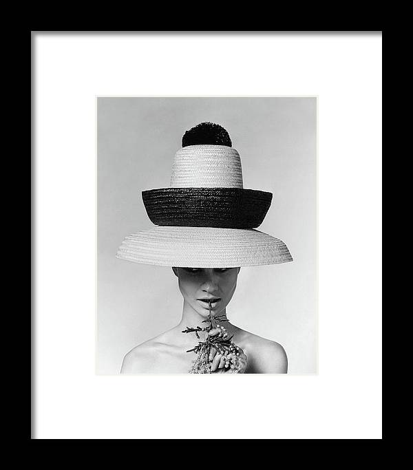 Accessories Framed Print featuring the photograph A Model Wearing A Sun Hat by Karen Radkai