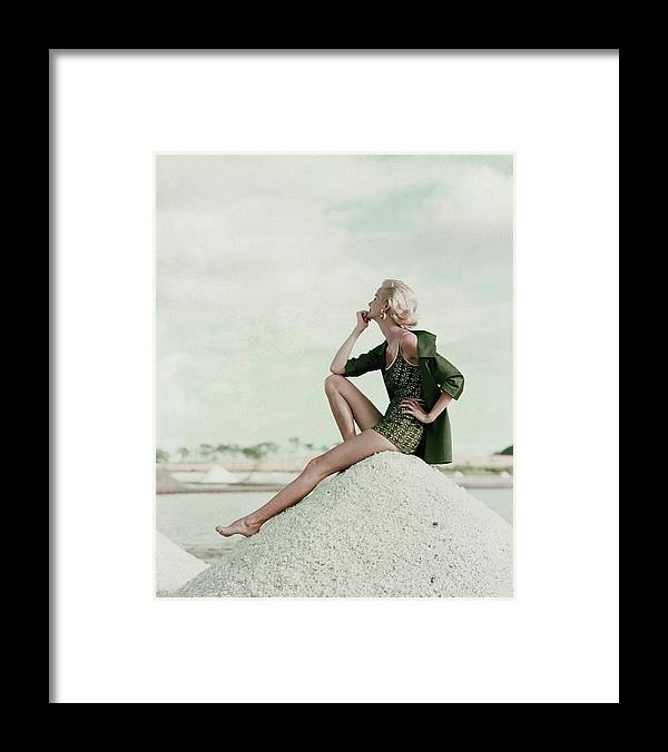 Exterior Framed Print featuring the photograph A Model Wearing A Swimsuit And Jacket by Leombruno-Bodi
