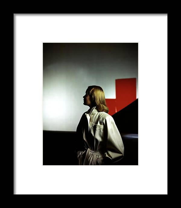 Fashion Framed Print featuring the photograph A Model Wearing A White Coat by Horst P. Horst