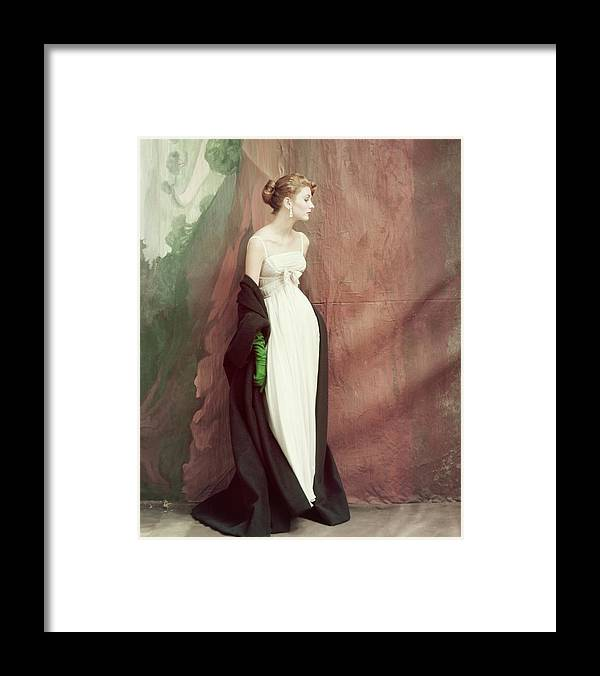 Accessories Framed Print featuring the photograph A Model Wearing A White Dress by John Rawlings
