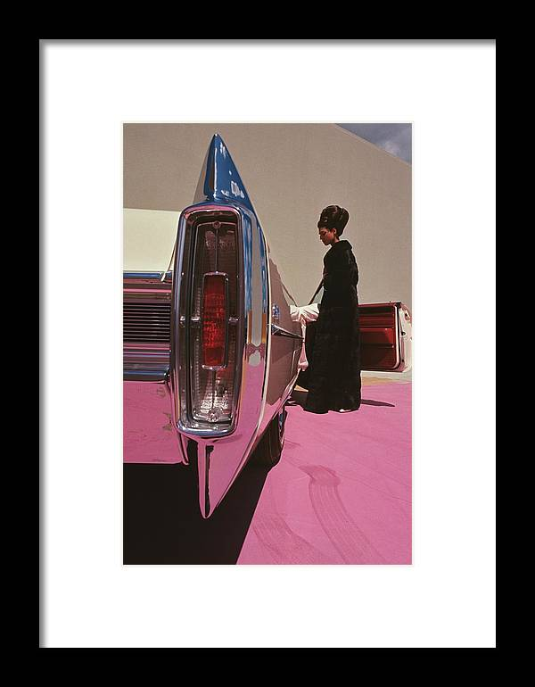 Auto Framed Print featuring the photograph A Model Wearing Emeric Partos Entering A 1965 by Gene Laurents