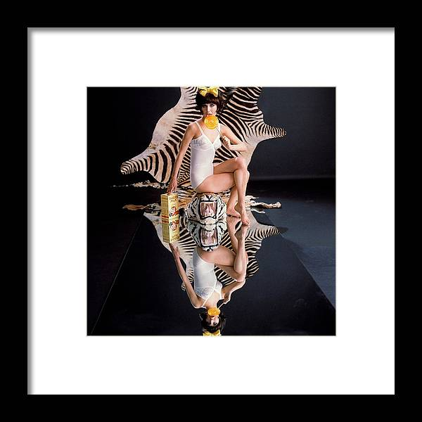 Fashion Framed Print featuring the photograph A Model With Animal Skins by John Rawlings