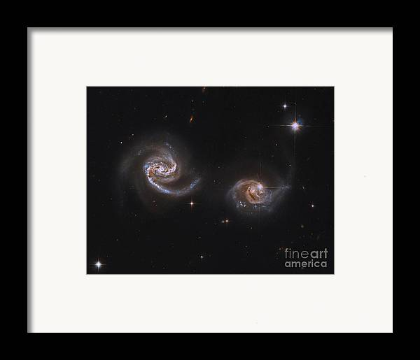 Horizontal Framed Print featuring the photograph A Pair Of Interacting Spiral Galaxies by Roberto Colombari