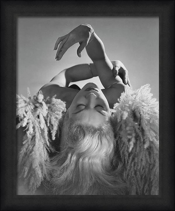 A Portrait Of Lisa Fonssagrives Lying by Horst P. Horst