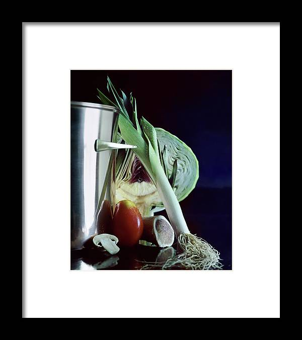 Still Life Framed Print featuring the photograph A Pot With Assorted Vegetables by Fotiades