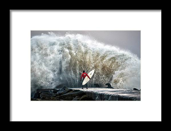 Professional Sport Framed Print featuring the photograph A Pro-surfer Waits For A Break In The by Charles Mcquillan